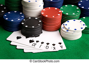 Royal Flush - A royal flush in spades with poker chips in...
