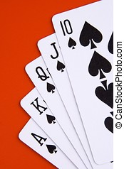 Royal Flush - Royal flush in spades with red background.