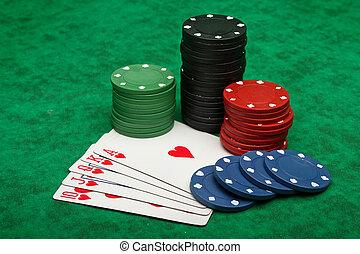 Royal Flush with gambling chips over green felt