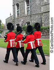 Royal Guards at Windsor Castle, in Windsor in the English county of Berkshire. It is the largest inhabited castle in the world and, dating back to the time of William the Conqueror, is the oldest in continuous occupation.