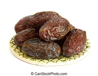 Royal large dates Medjool on a clay plate on a white background