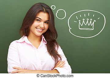 Royal thoughts - Portrait of pretty girl by the blackboard ...