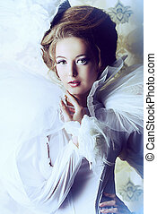 royal woman - Beautiful fashion model in the refined white...