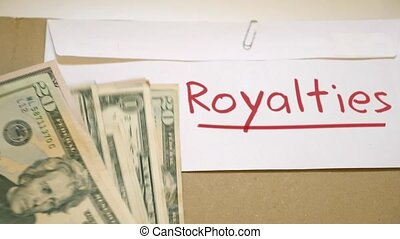 Royalties earnings concept - Royalties cash envelope