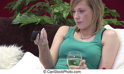 Woman relaxing with a Glass of Wine