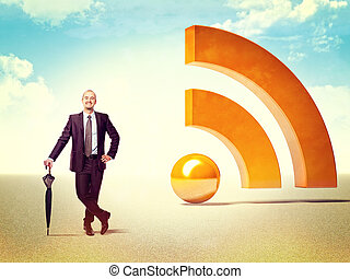 rss business - smiling businessman and 3d huge rss logo