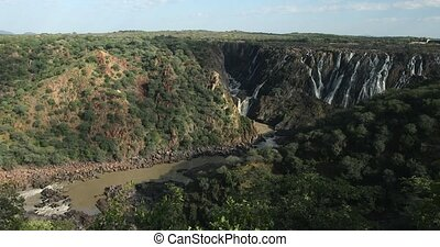 interesting Ruacana Falls on River Kunene in Northern Namibia, Africa wilderness landscape