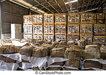 Rubber Bales in Warehouse - Image of rubber bales and crates...