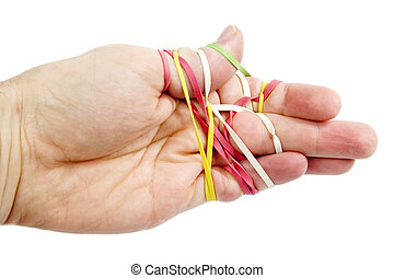 A male hand tangled in a mess of rubber bands. Isolated on white with clipping path.
