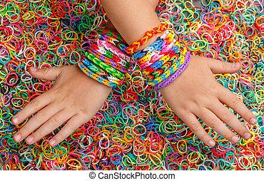 Rubber bands bracelets on hand