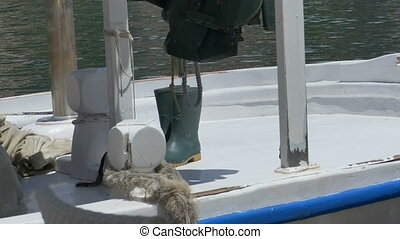 Rubber Boots on Fishing Boat - Rubber fisherman boots on the...