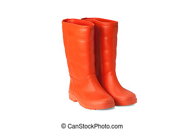 rubber boots - orange rubber boots on white background