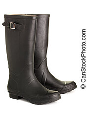 Rubber boots. - Black, rough rubber boots, isolated on a...