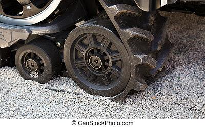 Rubber caterpillar track - Close up of rubber caterpillar...