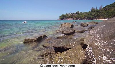 Rubber Dinghy Anchored off a Rocky Tropical Beach - FullHD...