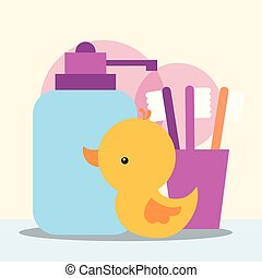 rubber duck toy dispenser liquid soap and toothbrushes bathroom