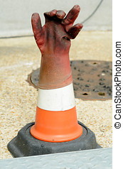 Rubber glove on traffic cone