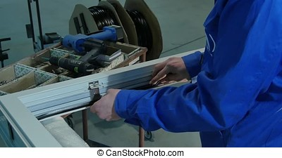 Rubber Insulation for glass and doors. Worker use Window...