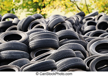 A waste heap of old tyres for rubber recycling