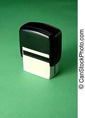 a rubber stamp on a green background