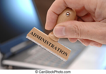 administration - rubber stamp in hand marked with...