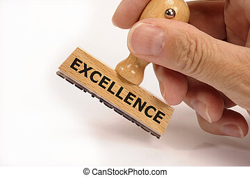 rubber stamp in hand marked with excellence