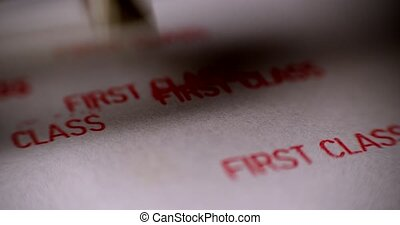 Rubber stamping that says 'First Class'. Many stamps - ...