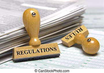 regulations and rules - rubber stamps marked with...