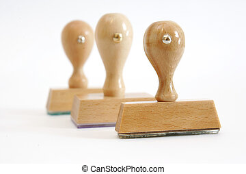 Three wooden rubber stamps in a row