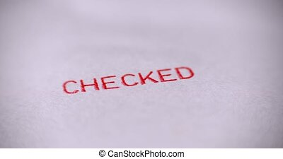 """Rubber stamps with the word """"CHECKED"""""""
