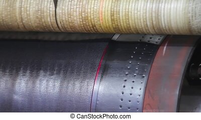 Manufacture of tires - Rubber tape is reeled up on a drum in...