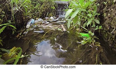 Rubbish and Litter Floating in an Irrigation Canal -...