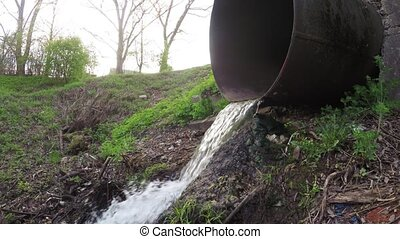 Rubbish and water sewer pipe - From the sewer pipe water...