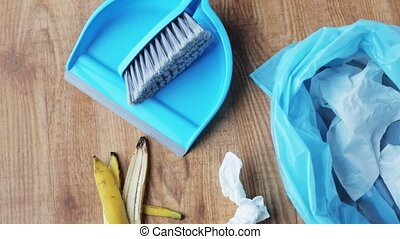 rubbish bag with trash and cleaning items at home -...
