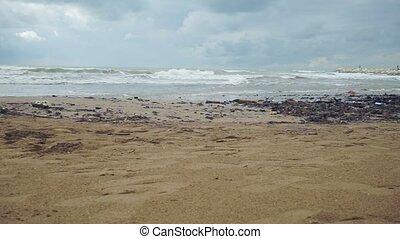 Rubbish on the beach. Environmental pollution. Static camera
