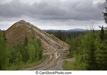 Rubble heap of gold and copper mine in Vasterbotten, Sweden.