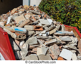 rubble from the demolition of a residential building in a...