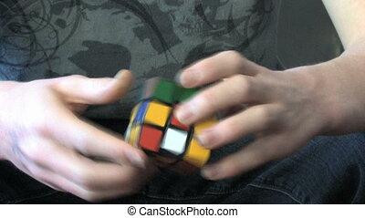 Rubik's Cube Genius - Hands of a master solving a rubik's...