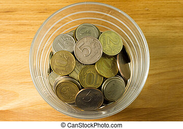 ruble coins in a glass cup