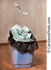 Rubles are thrown in the trash bin