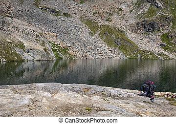 rucksack on a rock at a lake