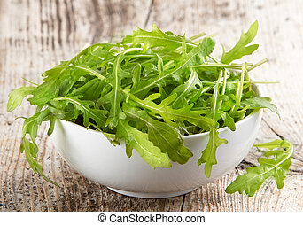 Rucola in white bowl