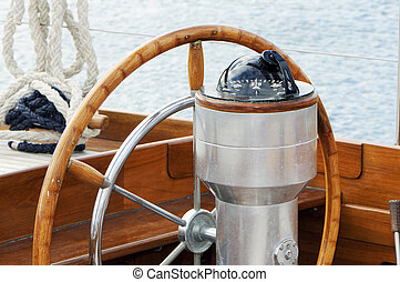 Detail of rudder and compass on a wooden sailboat