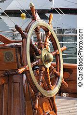 Steering wheel on a wooden boat