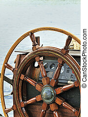 Wooden rudder and navigation instruments on a sailboat
