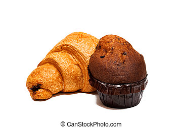 Ruddy croissant with chocolate and cupcake isolated on white background