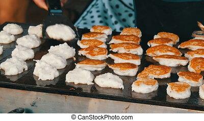 Ruddy pancakes fry in street. Thai food. Asian street food -...