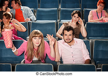 Rude Lady In The Audience - Rude young woman with man in ...