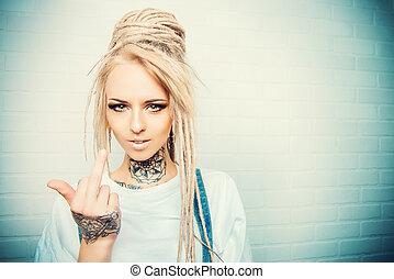 rudeness - Modern teenage girl with blonde dreadlocks ...