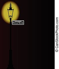 New Orleons street sign of Rue Bourbon with old gas street light over a dark background